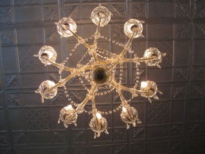 The antique tin ceiling reportably came from an old steamship.